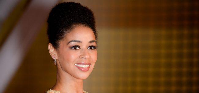 10 Penteados Updo elegante para mulheres de pele escura Photo