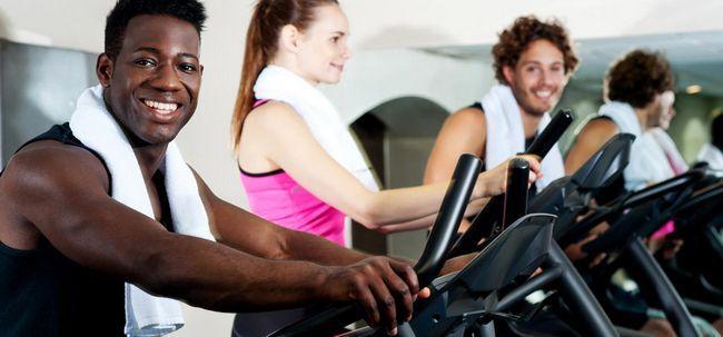 8 maneiras em que Gymming Ajuda a perder peso Photo